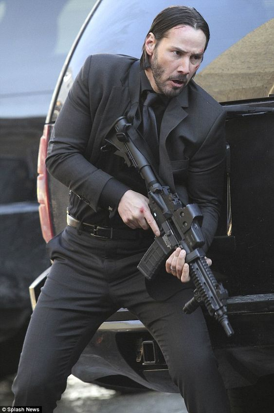 Poised and ready: The star plays the title character in the movie / Keanu Reeves as John Wick
