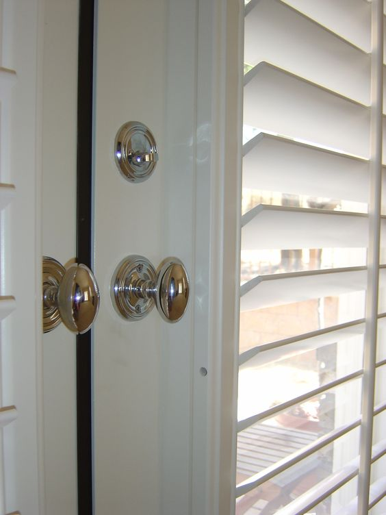 Shutters On French Doors With Oval Handles Close Up Home