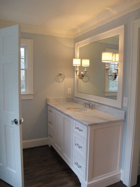 White vanity with dark wood flooring home pinterest for Dark paint colors for bathroom vanity