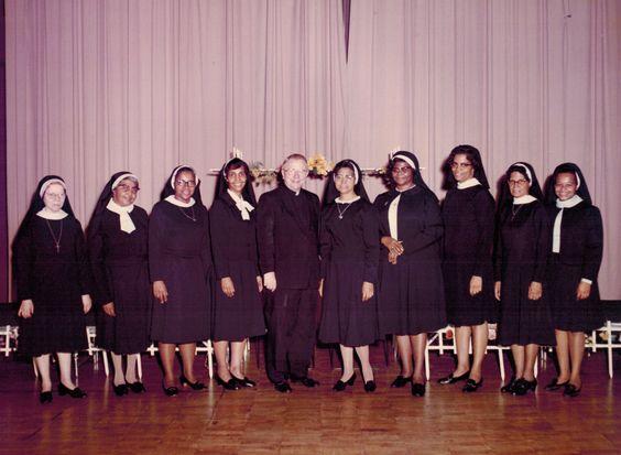 Sisters Regina, Germaine, Celestina, Noreen, Anthony, Richard, Marian, Isabell and Jocelyn flank Fr. Jordan at Bambino Gesu in 1972.