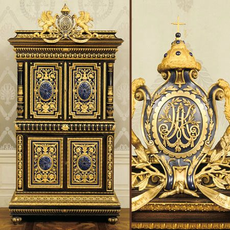 Gifts?: Saint Petersburg, 1873  Attributed to Nichols and Plinke;  Ippolit Antonovich Monigetti Ebonized wood, gilt bronze, lapis lazuli   Tsar Alexander II and his wife, Tsaritsa Maria Alexandrovna, presented this ebonized cabinet to Grand Duke Konstantin and Grand Duchess Alexandra Iosifovna, the tsar's brother and sister-in-law, on the occasion of their twenty-fifth wedding anniversary.At the top, a blue medallion contains the recipients' interlaced initials, A and K, the old crown of…