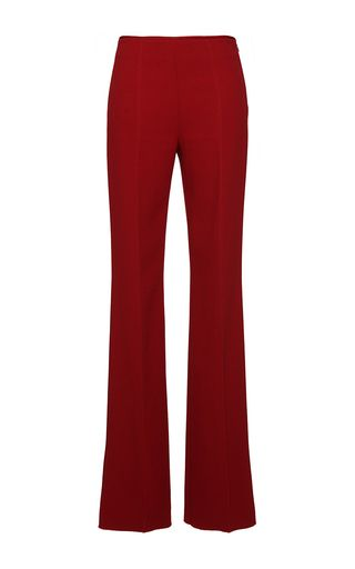 Crafted in wool, these **Agnona** trousers feature a high waist, exposed seams, and a flared leg.