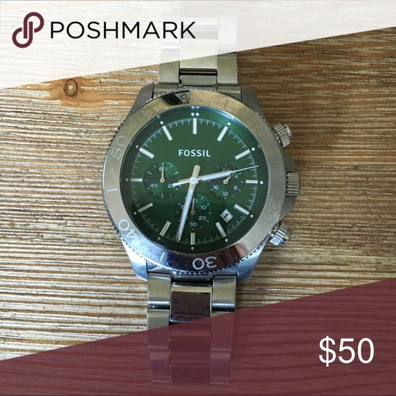 Men's Green Silver Fossil Stainless Steel Watch Men's Fossil watch. This watch is in good condition. It has minor markings on it of just wear & tear. Works great, but will need a new watch battery as it has sat for about 1 year in a drawer. My hubby never turned it off while it wasn't worn.  He has upgraded to an Apple Watch so he has no desire to wear any of his other watches from his collection. It still has the clear plastic sticker on the back. Doesnt come with a box either but I will…