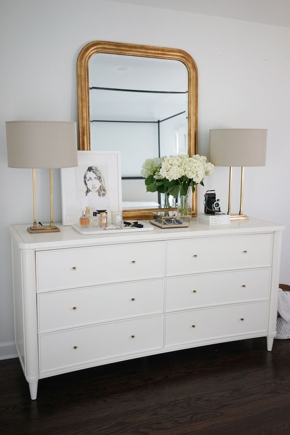 gold mirror on dresser