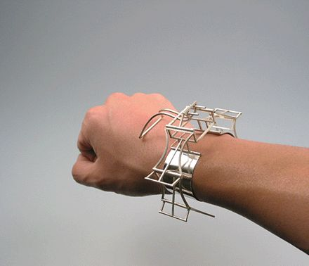 Mechanical Batwings kinetic bracelet. See it in action here http://www.duknoyoon.com/images/wing/wing03.gif