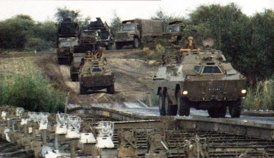 Ratels, Valkirie MRLs and supply trucks pull back across the Kavango River towards the end of the War for Africa
