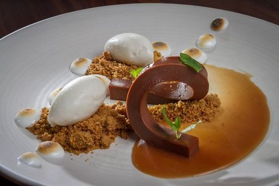The milk chocolate ganache at 1760 in SF has hickory ice cream and piped marshmallow stars browned with a blowtorch.