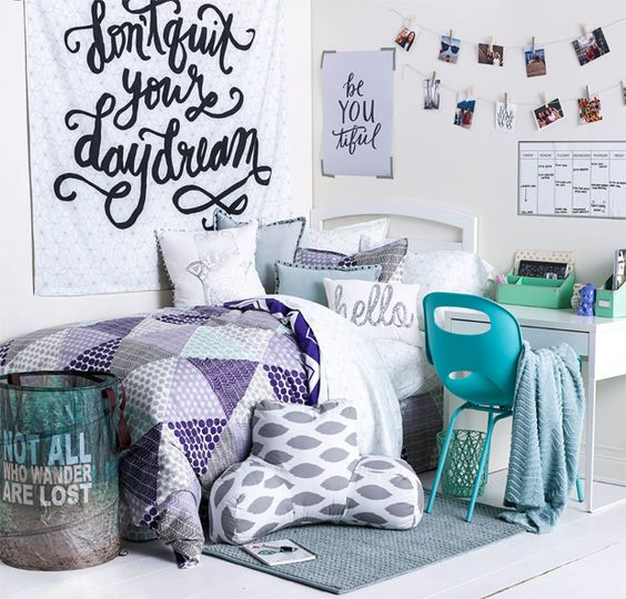 Purple, teal, and white dorm room decor