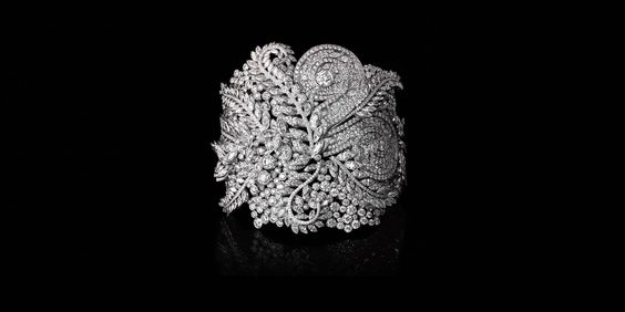 White Diamond Fern Cuff: Inspired by lush tropical gardens, this exquisite bracelet features sparkling diamonds set in platinum to create a harmonious fern motif. Round brilliant diamonds, carat total weight 34.96; marquise diamonds, carat total weight 23.70; pear-shaped diamonds, carat total weight 1.07.