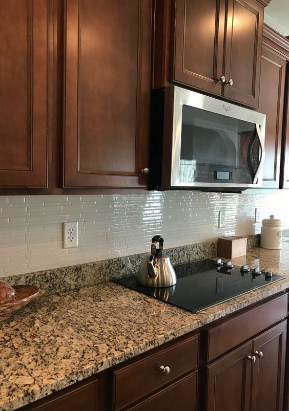 Engineered Stone Countertops Are Made From A Natural Quartz And Mixed With A Resin To Bind Kitchen Renovation Backsplash Kitchen Dark Cabinets Kitchen Cabinets