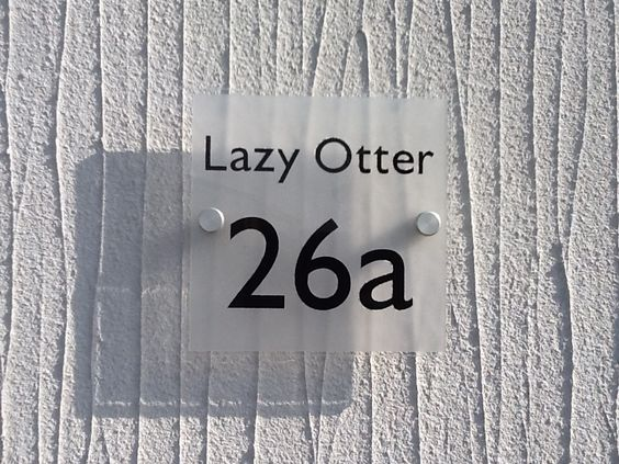 """Ever thought of giving your home a name? Like this Cool House Name Plate """"Lazy Otter"""" ❤️www.de-signage.com signs for houses - When only Something Special will do"""