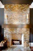 Glass tile fireplace.  Budget saver-try a center vertical strip of glass tile and a larger, inexpensive tile for the rest of the surround.