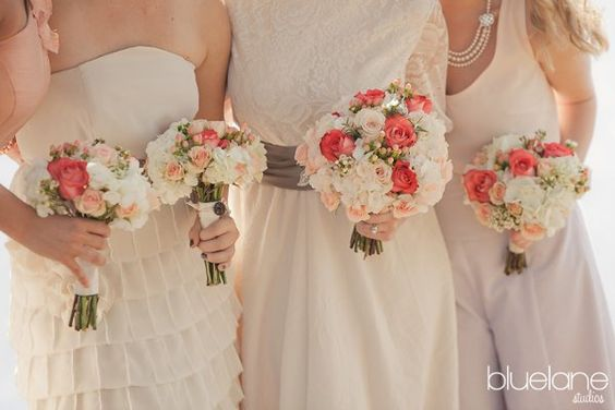 iguana (coral) rose and peach hypericum berry, peach and blush carnations and waxflower with ivory hydrangea.  Beautiful!
