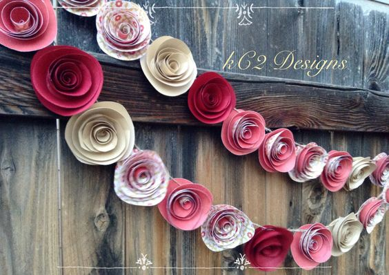 This garland is made of high quality paper in beautiful rich reds and golds. Each paper rose is hand cut and sculptured and measures between 2 and 2 1/2 inches, they're attached to a spun twine with r