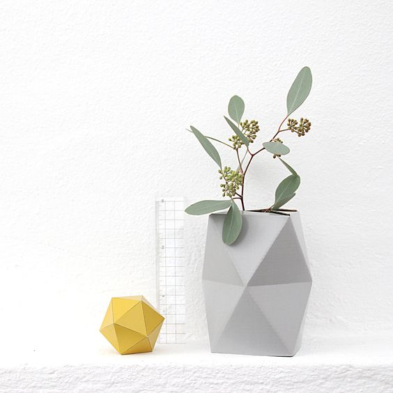 SNUG.VASE cardboard vase in combination with a small glass or bottle / availabe in to sizes and 3 colours