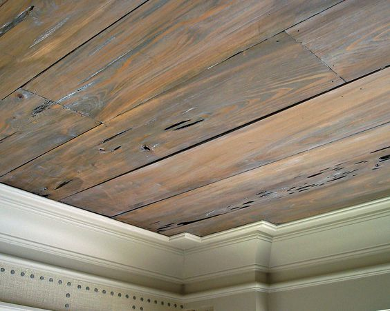 Pecky Cypress ceiling paneling.  Stained, gray wax topcoat.