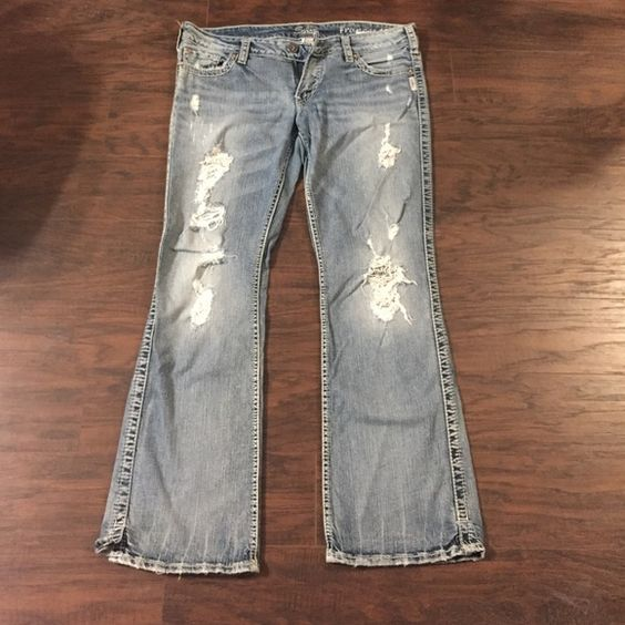 Silver Frances jeans Silver Frances jeans. Size is W34/L31 light wash, with distressing on front. Only wore a couple of times, great condition. Pant legs has small stitched slips at bottom. Silver Jeans Jeans Boot Cut