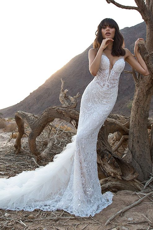 Sheath silhouette beaded gown in Chantilly lace with draped Swarovski crystals and a silk organza train. Pnina Tornai 2016 wedding dress collection