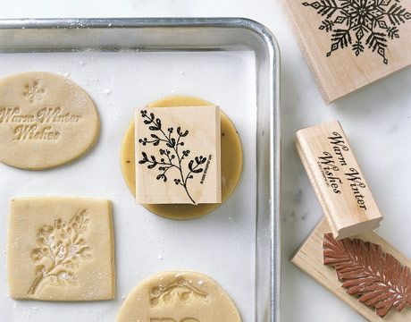 Using rubber stamps to make patterns on cookies.