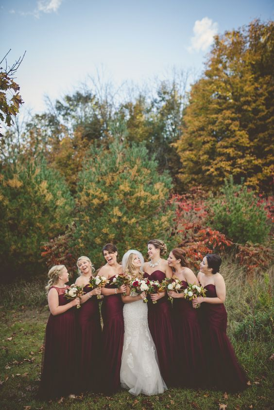 Bridesmaids in crimson dresses