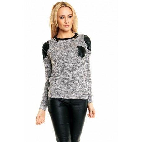 Rewelacyjny modny damski sweterek!  Najnowsza kolekcja.  Sweterek z przyjemnego materiału.  Wyróżnia się wstawkami z eko skóry.  Idealna propozycja dla pań ceniących sobie swobodny  a jednocześnie komfortowy styl.  MATERIAŁ: 8% poliamid, 20,2% poliester, 68,2 % wiskoza, 3,6% elastan
