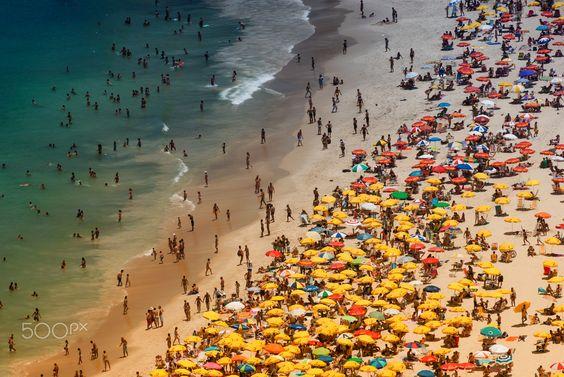 Aerial view Ipanema beach Rio de Janeiro - Tourists on Ipanema beach in Rio de Janeiro on a hot summer day.