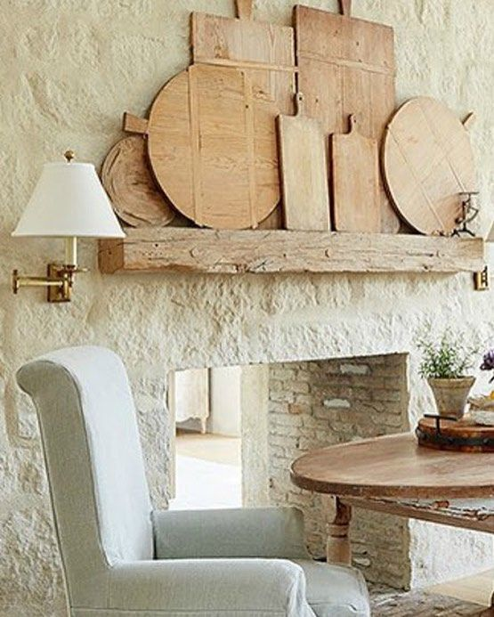 Patina Farm limestone fireplace in breakfast area. Giannetti Home. #limestone #fireplace #patinafarm