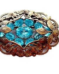 Antique Aqua Rhinestone Brooch, set in gilded filigree, dates to 1919