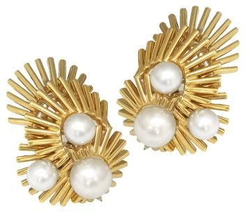 RUSER. This is gorgeous vintage 1960s 18k yellow gold earrings by Ruser. The earrings are set with elegant pearls measuring from 5mm to 7mm in diameter. The back of the earrings are in 14k yellow gold. The earrings measure 26mm by 19.5mm and weigh 20 grams. The earrings are signed RUSER 14k 18k.