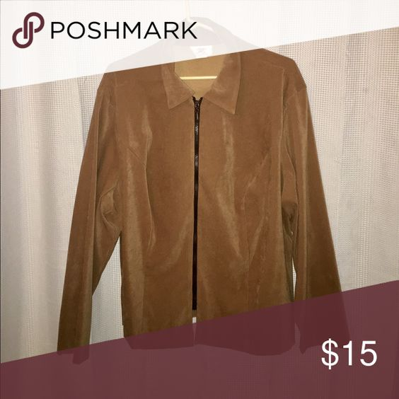 Beautiful Jacket or Blouse This great piece could either be worn as a jacket or a blouse. Would look fantastic as either. Cute zipper in the front.... 97% polyester and 3% spandex. Casual or Professional... JMS Collection Tops Blouses