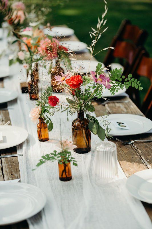Simple Wedding Centerpiece Brown Vessels With Greenery Flowers