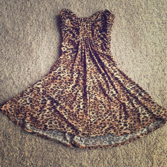 Cheetah print strapless dress Cheetah print dress with glitter mixed in. Looks great. Strapless and fun. Flows at the bottom. Double Zero Dresses Strapless