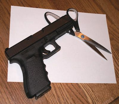Glock, Paper, Scissors - not hard to guess which one wins