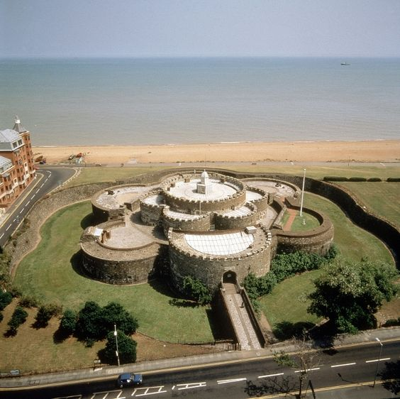 Deal Castle, UK is a 16th century coastal artillery fort built by Henry VIII. Deal Castle is built of Kentish ragstone brick, and Caen stone taken from nearby religious houses after the Dissolution of the Monasteries. Whether by design or coincidence, the fortress is shaped like a Tudor rose.