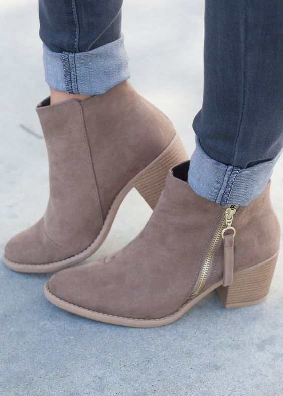 Make room in your closet, these transitional booties will be your best friend this fall! This simple and chic style features a faux suede upper, western-style paneling and stitching detail, size zippe: