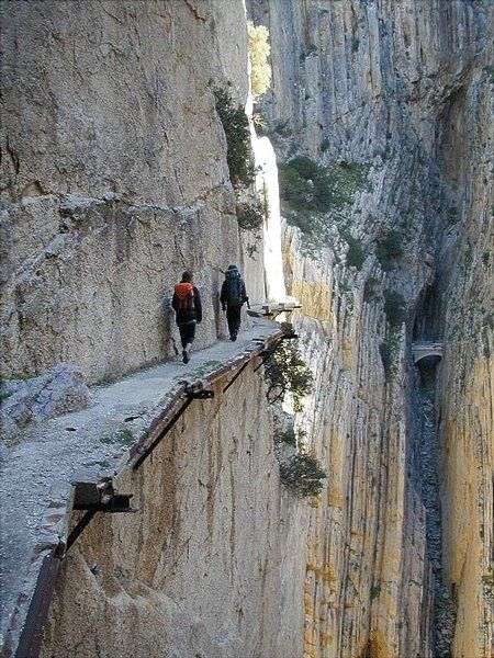 The Guadalhorce river gorge, Garganta del Chorro.  When the dam that created the reservoir below was completed in 1921, King Alfonso XIII of Spain viewed the results from a 1 meter (3 feet 3 inches) wide catwalk, el Camino del Rey, the King's Path, 100 metres (350 feet) above the river in Málaga, Spain.