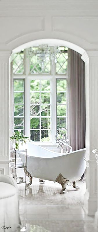 White bathroom window bright light claw foot tub for French bathroom decor