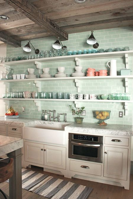 Green subway tile in a French farmhouse style kitchen with white open shelving. Come see this Rustic Elegant French Gustavian Cottage by Decor de Provence in Utah! #frenchcountry #frenchfarmhouse #interiordesigninspiration #rusticdecor #europeanfarmhouse #housetour