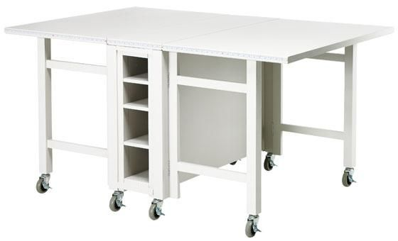 cutting table  http://www.homedecorators.com/P/Martha_Stewart_Living_Craft_Space_Collapsible_Craft_Table/400/