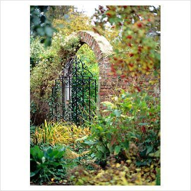 Decorative iron gate with brick archway