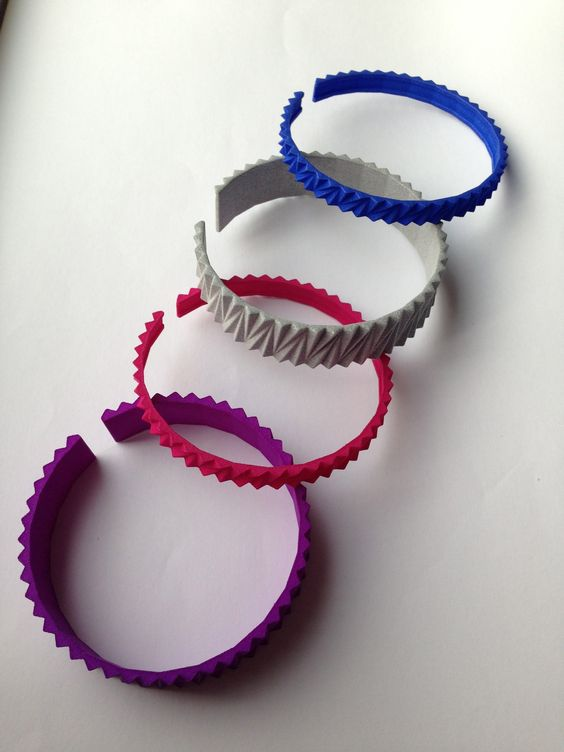 Colorful 3D-printed architectural bracelets; made of plastic: Flexible, Lightweight & Strong.  Get them on shapeways: Small: http://www.shapeways.com/model/1452672/bracelet-arch1.html?li=search-results&materialId=62  Big: http://www.shapeways.com/model/1486377/bracelet-arch1-big.html?li=search-results&materialId=6