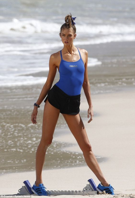 It's no (Victoria's) secret: Karlie Kloss poses on the beach in Barths, where she's filming a new fitness DVD