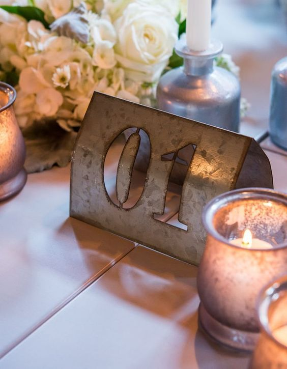 Styled Shoot: Chic Industrial Wedding Reception Ideas from Weddingstar - love the table number idea: