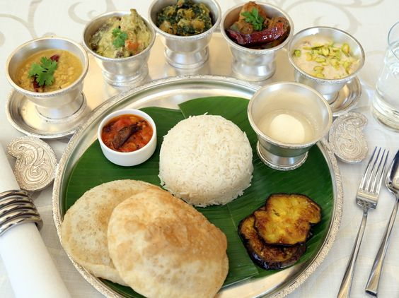 Auspicious Ashtami . If you plan to eat at home, why not try some 'Doi Fulkopi' (a traditional Bengali recipe of cauliflower cooked in yogurt) and 'Potoler Dolma' (stuffed Pointed gourd cooked in gravy, an iconic Bengali dish) with 'Mooger Dal' and 'Alu bhaja' as the favourite accompaniment to your steamed rice. —