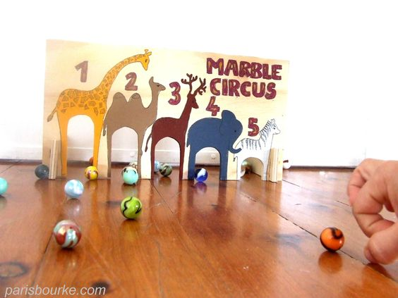 Marble Circus game. Can be made with wood or just a shoe box. Cute gift.