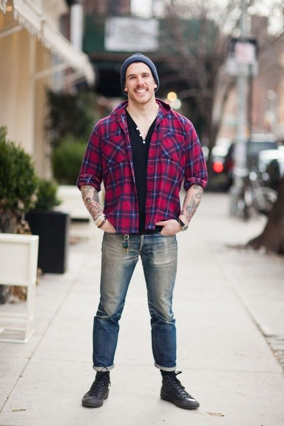 For an everyday outfit that is full of character and personality wear a red tartan button-down shirt with blue jeans. Mix things up by wearing black high top sneakers.  Shop this look for $92:  http://lookastic.com/men/looks/beanie-henley-shirt-longsleeve-shirt-jeans-high-top-sneakers/5794  — Charcoal Beanie  — Black Henley Shirt  — Red Plaid Longsleeve Shirt  — Blue Jeans  — Black High Top Sneakers