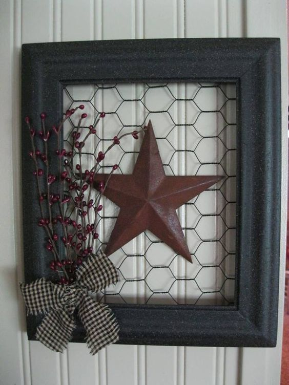 Easy to make for yourself ~ Empty frame, rusty barn star to fit, chicken wire, gingham ribbon and some pip berry. Then assemble.