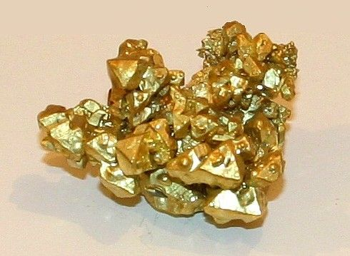 Gold (Au) Native Element- The most basic and common pattern for gold crystals is the octagon. This beautiful museum quality specimen shows a large number of octagonal whole crystals that have grown together into a solid mass.  The specimen weighs several ounces and was taken from a gold mine in California in the late 1800s.