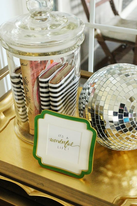 Kate Spade-Inspired Bar Cart Styling - love the striped books and disco ball!