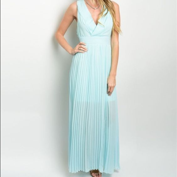 Aqua blue dress Brand new dress prefect for prom or any formal occasions size medium pleated chiffon , partial lining and plunging neckline Dresses Prom